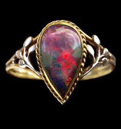 An Arts & Crafts opal ring, by Liberty & Co., circa 1905. Gold, silver leaves, with a fine black opal. #opalsaustralia