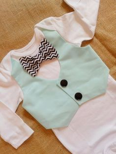 Baby boy bow tie/vest onesie Light mint blue with black and white chevron. Great for birthday, party, wedding, photos, Easter/spring. $26.99, via Etsy.