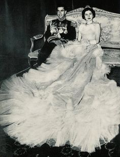 The Shah of Iran.and Soraya Soraya Esfandiari Bakhtiari, 12th of February 1951, at the famed Hall of Mirrors at the Golestan Palace amidst much pomp and circumstance. The wedding guests numbered 1,600 according to some news reports.  She wore a beautifully crafted wedding dress by Christian Dior consisting of 37 yards of silver lame with 20,000 feathers and 6,000 diamond pieces sewn on.