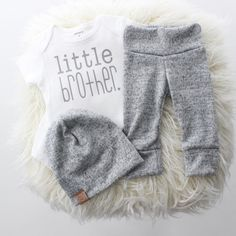 The perfect 3 piece take home outfit for your sweet baby boy! Outfit includes white & grey Little Brother onesie, grey brushed knit leggings & matching slouch hat.