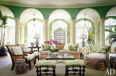 The lush garden room at a Tudor-style manse near the Hudson River