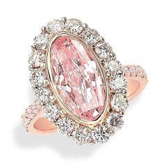 Rosamaria G Frangini | High Pink Jewellery | Pink Oval Ring - Ring with Fancy Pink moval shaped brilliant diamond accented with round white brilliant diamonds and white diamond melee in 18kt rose and white gold.