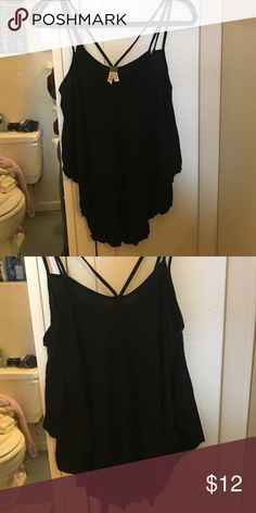 Free people tank Flowy tank, longer in front and back, shorter on sides. Soft material. Great condition. Free People Tops Blouses