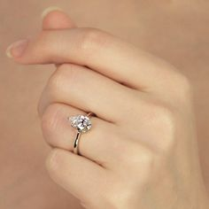 A gemstone solitaire may be the essential diamond engagement ring. Although other diamond engagement ring settings fall and rise in recognition, a solitaire ring is really a classic with constant, … Wedding Rings Simple, Wedding Rings Solitaire, Wedding Rings Vintage, Bridal Rings, Unique Rings, Wedding Jewelry, Halo Rings, Simple Rings, Stylish Rings