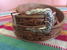 A personal favorite from my Etsy shop https://www.etsy.com/listing/464764798/western-floral-tooled-leather-belt-with