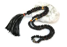 A shophisticated mala necklace of 108 gemstones of Lava  among 5 Agate Fire Black Orange surrounded