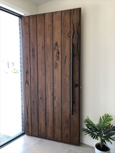 Recycled messmate clad front door coated in OSMO tobacco stain. Timber Revival, Melbourne. Made in Melbourne, shipped nationally around Australia. #frontdoor #timberdoor #recycledtimberdoor  #messmate
