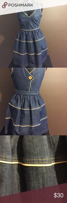 Berate Johnson Denim dress Denim  V front and back with gold trim dress. Sleeveless,  hem fits  above knee zipper on side Betsey Johnson Dresses Mini
