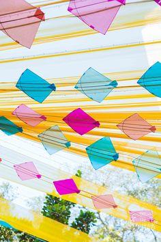 Easy and fun kite décor idea for a funky mehendi or haldi function! WedMeGood #wedmegood #indianweddings #mehendi #haldi #decorideas #mehendidecor #haldidecor #kites #kitedecor