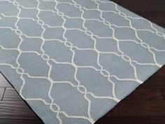 Lattice Dhurrie Rug | Dhurrie Rugs are known around the world for their sturdy character and delightful colors. This slate blue dhurrie was made by hand in India of wool with a papyrus lattice. Last but not least, it's also reversible. Tinnin Imports