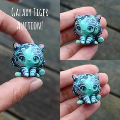 Edit: *Bidding CLOSED* 🐈✨✨✨ Hi everyone! Here is the auction for this turquoise Galaxy Tiger! It has been hand sculpted and painted over several days with lots of care and detail. It is smaller than it appears in the picture: just under 3cm in height. It is matte glazed with glossy, lightly domed eyes. You can see more pictures through the link in profile ✨🐅✨ ✨ The auction starts now and will run until tomorrow the 26 Sept at 9am NZDT. This will hopefully give everyone a chance to bid…