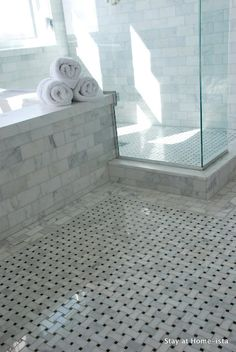 Woven bathroom floor and marble subway tiles