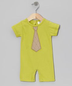 Made from soft organic cotton, this dapper romper is extra gentle on sensitive skin, while a stitched-on tie helps it look extra sweet. This fun and functional design features snaps in back and at the legs for easy changing.100% organic cottonMachine washImported