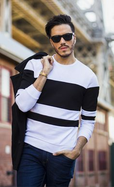 Spring Mens Fashion - Urban Men Street Style 2017. Featuring sunglasses, stylish black and white sweater, and dark navy jeans. Click here for more awesome outfits.
