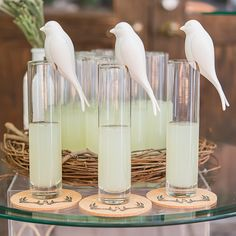 This perching white ceramic bird Makes great decor and acts as a favor from http://shop.glitzybubbly.com