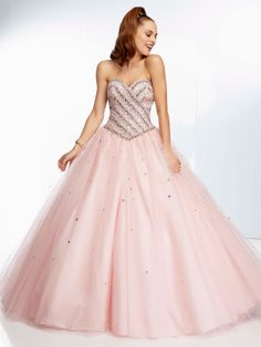 This lovely ball gown will make you a fairy princess on your prom night. This tulle prom dress paparazzi by Mori Lee 95001 features a sweetheart neckline, gorgeous jewel beaded bodice, and a basque waistline. A ball gown skirt with scattered beading completes this look. Corset tie back. This prom dress comes in these colors: blush and bahama blue. This amazing dress is a great choice for your prom, homecoming, sweet 16 or any special event. Finish this beautiful look with long crystal…