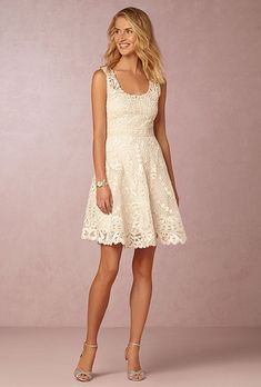 """Anouska"" sleeveless ivory fit-and-flare dress with a scalloped hemline, $320, Yoana Baraschi available at BHLDN"