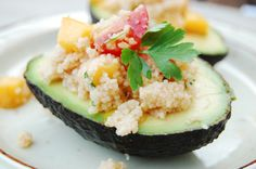 Need to try this - looks amazing! Avocado filled with mango coucous.