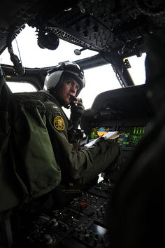 Navy pilot checks communications in an MH-60S Sea Hawk helicopter as it prepares to land | Flickr - Photo Sharing!