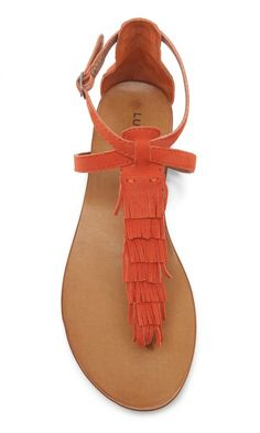 Orange suede fringe flat sandal