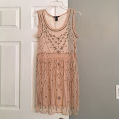 Sheer slip dress This beautiful sheer slip dress resembles the free people beaded mesh dress. This one is from forever 21. Forever 21 Dresses Mini