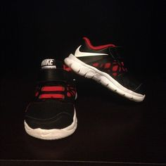 Toddler boy Nike shoes Gently worn toddler boy Nike shoes. Black and red. No blemishes. Practically new. Size tag on the inside tongue of the left shoe is coming off, leaving it on so you can see they are both the same size and you can take it off upon receiving. Nike Shoes