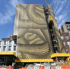 Yayoi Kusama, Yellow Trees building wrap at 345 West 14th Street at 9th Avenue, New York (installation view). Image courtesy DDG Partners