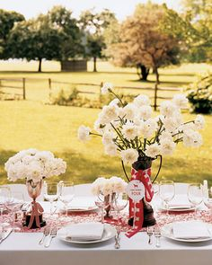 Google Image Result for http://dreamweddingreceptions.com/wp-content/plugins/jobber-import-articles/photos/110327-different-white-wedding-centerpieces-4.jpg