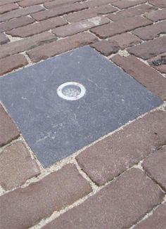 Verlichting in de bestrating met een stukje natuursteen