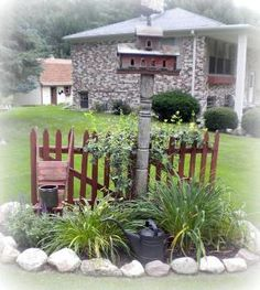 Pretty garden vignette with watering can, birdhouse on a post and partial picket fence.  earthy comfy casual: 8/1/11 - 9/1/11 by shari