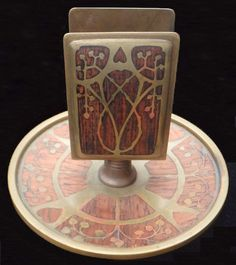 Erhard & Söhne, Art Nouveau match stand, brass with rosewood intarsia, early 1900's