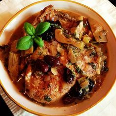 Pressure cooker chicken thighs with artichokes and black olives.Chicken thighs with vegetables cooked in pressure cooker.Easy and delicious