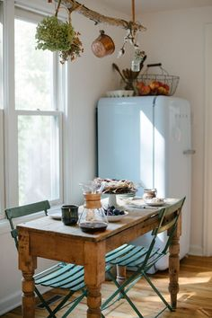 a french farmhouse inspired kitchen, kitchen design love the idea of something hanging over table... for drying herbs, or little glass jars with flowers, etc.