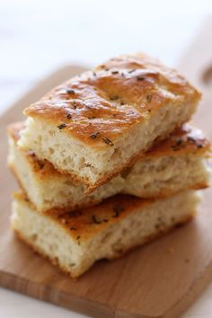 FOCACCIA BREAD  YIELD: 8 to 10 servingsCOOK TIME: 30 minutesTOTAL TIME: 3 hours 5 minutes ==ingredients==  1 3/4 c warm (110-115°F) water, 1 package (2 1/4 t) instant yeast, 5 sprigs fresh rosemary leaves, 1 T granulated sugar, 5 1/4 c (23.63 or 670 grams) all-purpose flour plus more for kneading, 1 T kosher salt plus coarse sea salt for sprinkling, 1 c extra-virgin olive oil divided  ================