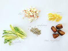 Gyümölcsös téli saláta Aranyfalatokkal 5 hozzávalója: szívsaláta, alma, narancs, napraforgómag, Medve Aranyfalatok