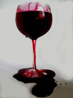 Wine glass over flowing with blood
