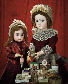View Catalog Item - Theriault's Antique Doll Auctions - 2 French Bisque Bebe Steiners - circa 1888 - with a collection of Antique Candy Boxes