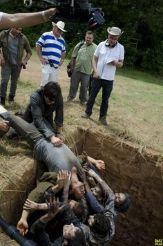 HERE HE IS HALF IN THE PIT, HE HAS TO GET OUT!!!  twd https://www.facebook.com/ZombieCPC