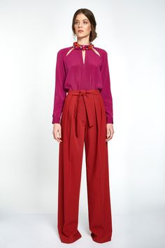 These wide leg pants are made from a soft touch wool blend for a comfortable and elegant wear. The high rise palazzo cut gives a taller allure to the legs, best worn with a tucked in shirt or top. Easy to adjust at waist with the constructed belt that knots for a subtle detail. #viktoriavarga #viktoriavargabudapest #designer #hungariandesigner #handmade #ootd #outfit #terracotta #wool #trousers #wooltrousers Best Wear, Collar Top, Palazzo, Wide Leg Pants, Terracotta, Wool Blend, Knots, Trousers, Touch