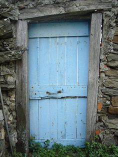 A wooden entry door that withstood the elements and withering for generations. . If only the walls could talk.
