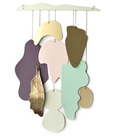 This decorative mobile can be hung directly on the wall or from the ceiling in an elegant nursery or even a grown-up powder room. The unique, organic shapes of pastel paper and gold foil accents will catch the light of the setting sun or sway in the breeze from an open window.