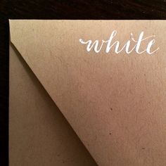 White modern calligraphy on kraft by @thecurlyquill