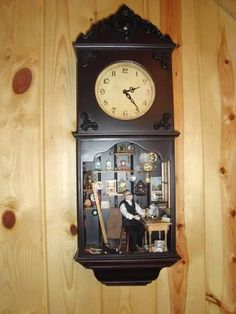 clock shop in a clock. this is my fetish, i swear: dollhouses in weird places.