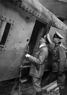 Hitler and Keitel examine the handiwork of the Stukas upon a Polish armored train. This is a rare photo of the Fuehrer actually carrying a sidearm. Hitler almost never went armed. According to some historians, he almost always, did wear a hat with defensive lining, the equivalent of a helmet.
