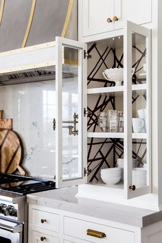 Love the wallpaper on the inside of these glass kitchen cabinets!