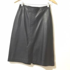 Barney's black leather skirt Soft black leather skirt from Barneys, knee-length. The back has zip-up and 6.5 inch slit. Length is 23.5 inches. Waist is 13 inches across. Barneys New York CO-OP Skirts Midi