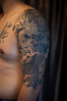 Black And Grey Phoenix Tattoo On Man Left Half Sleeve