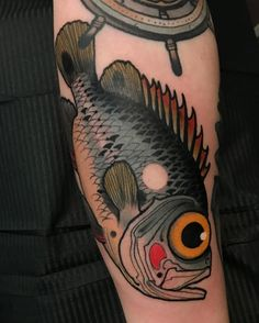new traditional colorful fish tattoo on arm