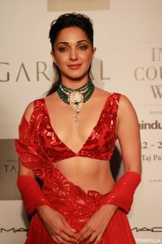 ICW Kiara Advani in Amit Aggarwal red lehenga choli July ICW 2019 (Indian Couture Week, Bollywood actress Kiara Advani looks ravishing in red lehenga n choli with deep V neckline, w/ gorg as she struts down the Bollywood Actress Hot Photos, Indian Bollywood Actress, Bollywood Girls, Beautiful Bollywood Actress, Most Beautiful Indian Actress, Bollywood Celebrities, Bollywood Fashion, Indian Actresses, Lehenga Choli