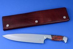 """""""Concordia"""" fine master chef's knife, obverse side view in CPM154CM high molybdenum powder metal technology tool steel blade, 304 stainless steel bolsters, Brecciated African Jasper gemstone handle, chef's roll case in latigo side leather and leather shoulder, hand-tooled, hand stitched with stainless steel snaps"""